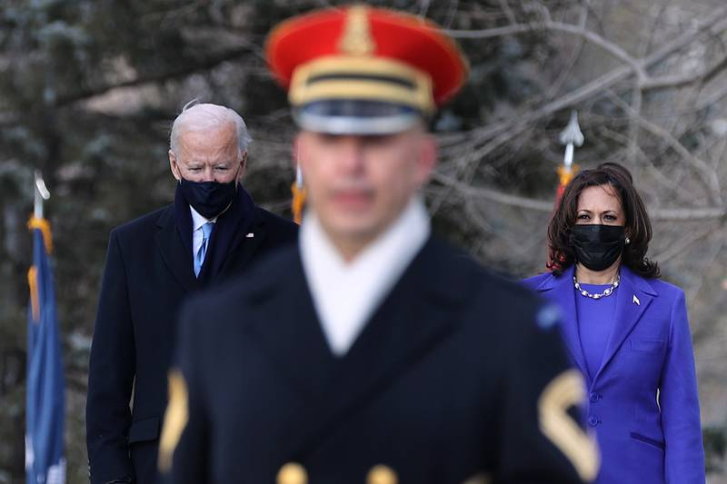 President Joe Biden and Vice President Kamala Harris attend a wreath-laying ceremony at Arlington National Cemetery's Tomb of the Unknown Soldier after the 59th Presidential Inauguration ceremony at the Capitol Jan. 20, 2021, in Arlington, Va.