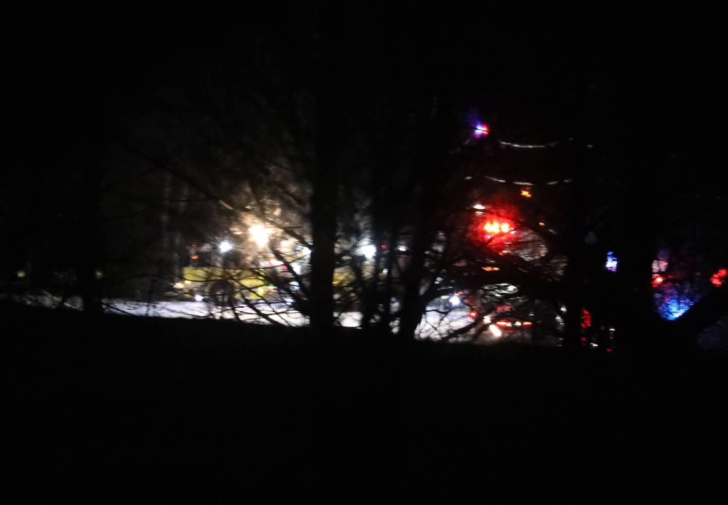 Mendon firefighters and other emergency personnel respond to a military helicopter crash in a field near Cheese Factory Road and W. Bloomfield Road in Mendon, N.Y., late Wednesday, Jan. 20, 2021.