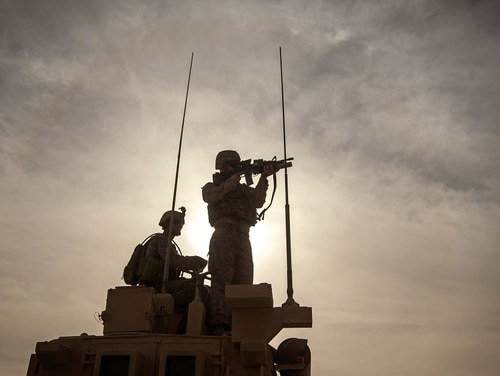 U.S. Marine Cpl. Spencer Knudson, vehicle commander with the Combined Anti-Armor Team, Weapons Company, 1st Battalion, 7th Marine Regiment, scouts for various avenues of approach and egress points on al-Asad Air Base, Iraq, on Oct. 23, 2015. The unit is the ground combat element of the Special Purpose Marine Air-Ground Task Force – Crisis Response – Central Command 16.1, which supports the Combined Joint Task Force – Operation Inherent Resolve. (Cpl. Akeel Austin/U.S. Marine Corps)
