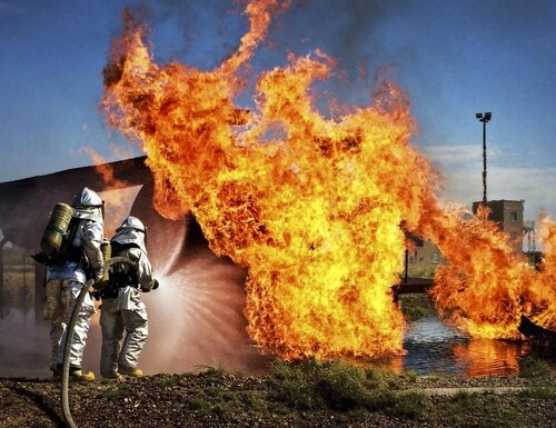 Air Force commandos practice extinguishing an aircraft fire during an exercise on Cannon Air Force Base, N.M., Aug. 14, 2015. (Staff Sgt. Alexxis Mercer/Air Force)
