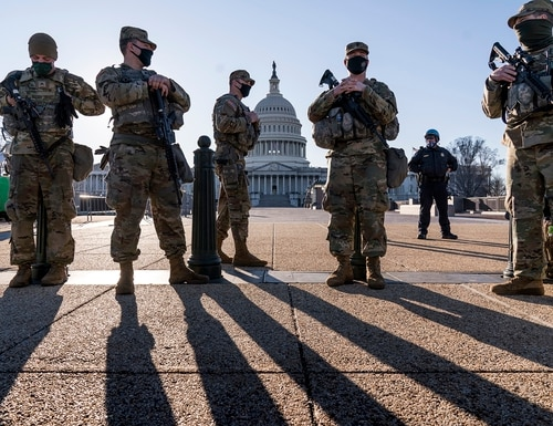 Members of the Michigan National Guard and the U.S. Capitol Police keep watch as heightened security remains in effect around the Capitol grounds since the Jan. 6 attacks by a mob of supporters of then-President Donald Trump, in Washington, Wednesday, March 3, 2021. (J. Scott Applewhite/AP)