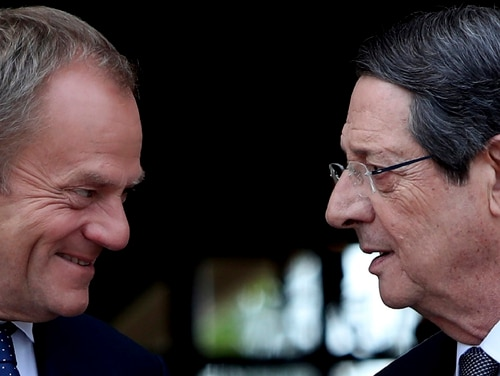 The president of Cyprus, Nicos Anastasiades, right, talks with European Council President Donald Tusk at the presidential palace in the divided capital Nicosia on Friday. (Petros Karadjias/AP)