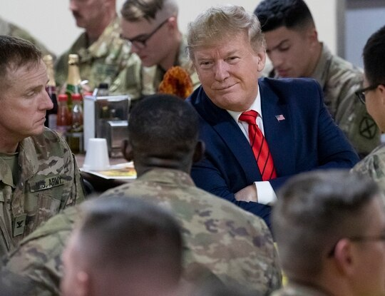 President Donald Trump smiles while sitting with the troops during a surprise Thanksgiving Day visit to the troops, Thursday, Nov. 28, 2019, at Bagram Air Field, Afghanistan. (Alex Brandon/AP)