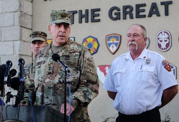 Maj. Gen. John Uberti, Fort Hood deputy commander, center, Col. Todd Fox, left, and Fort Hood fire chief Coleman Smith, right, speak to the media during a news conference in Fort Hood, Texas, on Friday, June 3, 2016. Officials say Fort Hood commanders were in the process of closing roads on the sprawling Army post in Texas when a truck carrying 12 soldiers overturned in a fast-flowing flooded creek during a training exercise on Thursday. (Rodolfo Gonzalez/Austin American-Statesman via AP) AUSTIN CHRONICLE OUT, COMMUNITY IMPACT OUT, INTERNET AND TV MUST CREDIT PHOTOGRAPHER AND STATESMAN.COM, MAGS OUT; MANDATORY CREDIT