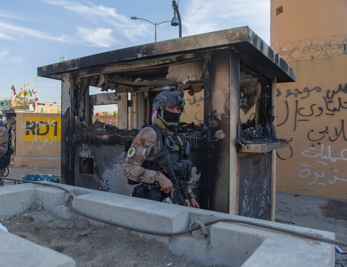 In this Jan. 1, 2020, file photo, Iraqi army soldiers are deployed in front of the U.S. Embassy, in Baghdad, Iraq. (Nasser Nasser/AP)