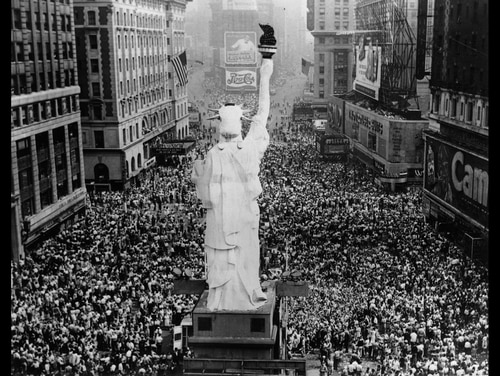 Crowds cheer in Times Square as President Truman announces the formal signing of the Japanese Instrument of Surrender at the end of World War II, Sept. 2, 1945. A scaled-down version of the Statue of Liberty is in the foreground. (Keystone/Hulton Archive/Getty Images)