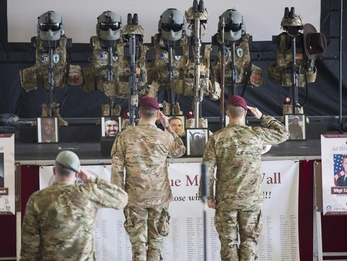 Lt. Col. Timothy Hanks, middle, 308th Rescue Squadron commander, and Chief Master Sgt. Mike Ziegler, right, 308th RQS chief enlisted manager, salute Master Sgt. William Posch, Staff Sgt. Carl Enis and the rest of the Jolly 51 crew who were killed in a helicopter crash in Anbar Province, Iraq, earlier this month, during a memorial ceremony March 27, 2018 at Patrick Air Force Base, Florida. Posch and Enis were assigned to the 308th Rescue Squadron. (Matthew Jurgens/Air Force)