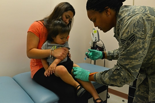 In the midst of the pandemic, it's important to keep all immunizations up to date. Here, Air Force Senior Airman Tamika Bradley prepares to administer a vaccine to a child at Shaw Air Force Base, S.C., in 2016. (Airman 1st Class Destinee Dougherty/Air Force)