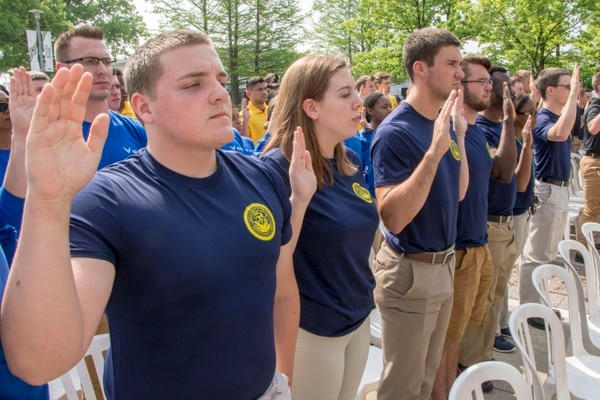 Navy Recruiting District Michigan recruits took the oath of enlistment during a joint service enlistment ceremony on Armed Forces Day Weekend at Indianapolis Motor Speedway in May. (Mass Communication Specialist 1st Class Stephen D. Doyle II/Navy)