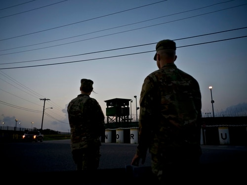 In this Tuesday, June 5, 2018, photo, reviewed by U.S. military officials, troops stand guard outside Camp Delta at the Guantanamo Bay detention center, in Cuba. (Ramon Espinosa/AP)
