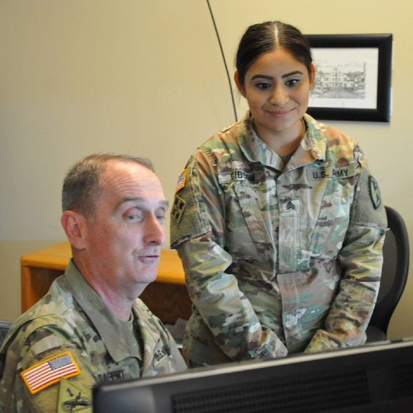 Command Sgt. Maj. David Davenport, left, the senior enlisted soldier for Training and Doctrine Command, talks to Sgt. Elizabeth Gibson, who was on staff duty at Fort Benning, Ga., Aug. 23, 2017. (Army)