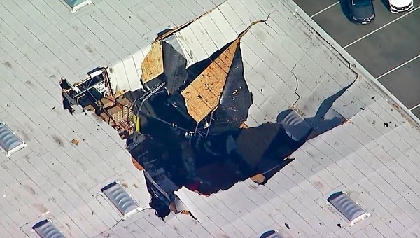 This photo taken from video provided by KABC-TV shows where an F-16 fighter jet crashed into a warehouse just outside March Air Reserve Base in Riverside, Calif., Thursday. (KABC-TV via AP)