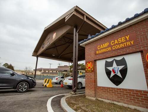 Soldiers stationed on U.S. Army Garrison Casey conduct pre-screening processes on individuals awaiting entry to the base, USAG-Casey, Dongducheon, Republic of Korea, Feb. 26, 2020. (Sgt. Amber I. Smith/Army)