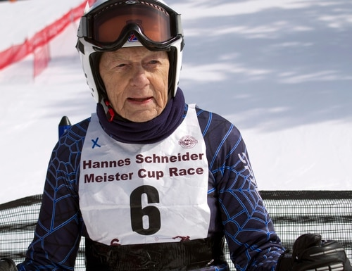 CORRECTS THE RACE WAS NOT A CHARITY RACE - In this photo taken Saturday March 7, 2015, WWII 10th Mountain Division veteran Richard Calvert of Wolfeboro, N.H. , rests at the bottom of the mountain after racing at the Cranmore Mountain ski area in North Conway, N.H. Calvert joined former and current members of the division at a ski race.(AP Photo/Holly Ramer)