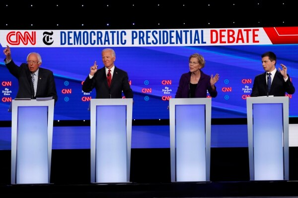 Democratic presidential candidate Sen. Bernie Sanders, I-Vt., from left, former Vice President Joe Biden, Sen. Elizabeth Warren, D-Mass., and South Bend Mayor Pete Buttigieg all gesture to speak during a Democratic presidential primary debate at Otterbein University in Westerville, Ohio, on Oct. 15. (John Minchillo/AP)