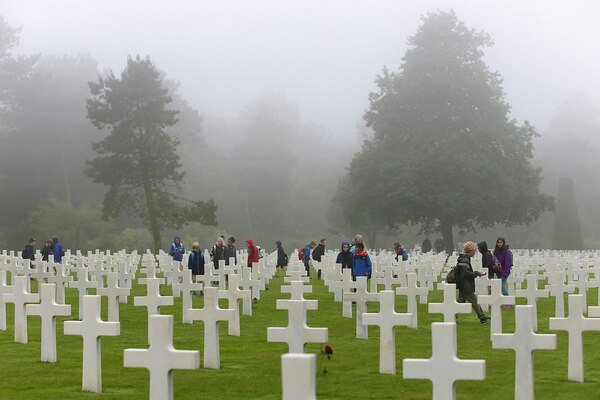 School children visit the Colleville American military cemetery in Colleville sur Mer, France, Wednesday June 6, 2018, on the 74th anniversary of the D-Day landing. (David Vincent/AP)