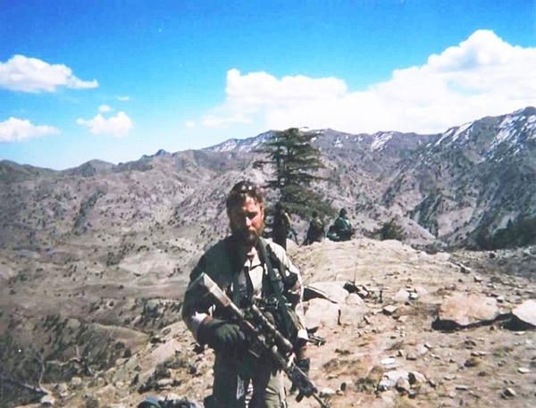 Britt Slabinski on Takur Ghar during Operation Anaconda, 2002 (Photo US Navy)