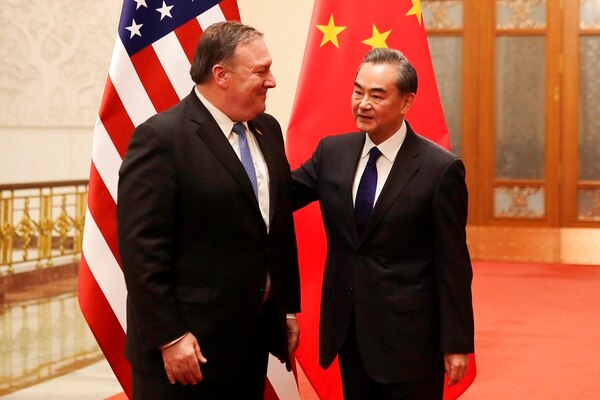 U.S. Secretary of State Mike Pompeo, left, chats with Chinese Foreign Minister Wang Yi before their meeting at the Great Hall of the People in Beijing, Thursday, June 14, 2018. (Andy Wong/Pool via APl)