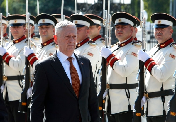 U.S. Defense Secretary James Mattis walks past an honor guard squad during a welcome ceremony upon his arrival at the government building in Skopje, Macedonia, Monday, Sept. 17, 2018. (Boris Grdanoski/Associated Press)