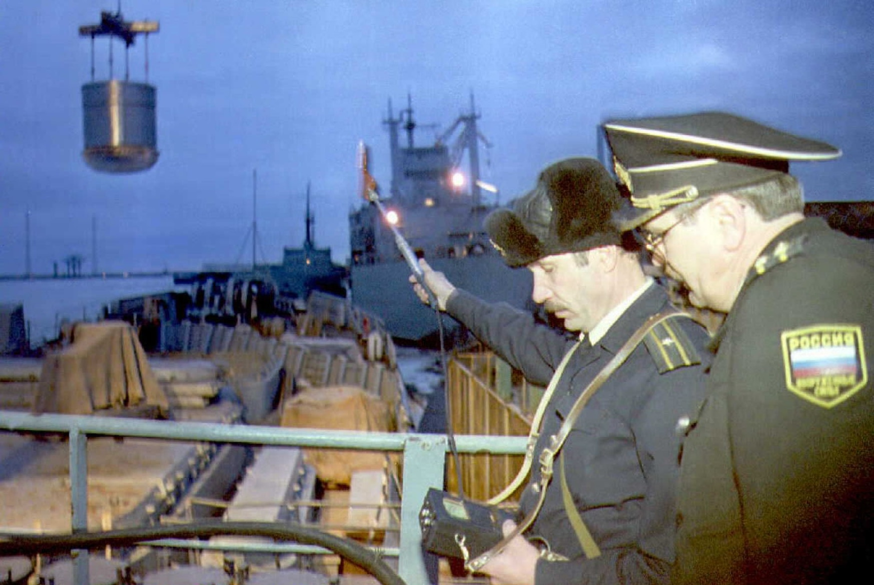 Two Russian Navy officers check radioactive levels during the unloading process of nuclear fuel from a nuclear submarine at the military shipbuilding plant Zvezda in Severodvinsk in March 1995. (EP/AFP via Getty Images)