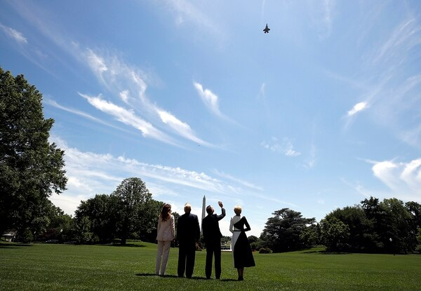 President Donald Trump, first lady Melania Trump, Polish President Andrzej Duda, and his wife Agata Kornhauser-Duda watch a flyover of a F-35 Lightning II jet at the White House, Wednesday, June 12, 2019, in Washington. (Alex Brandon/AP)