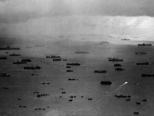 In this handout from the U.S. Navy, units of the U.S. Fifth Fleet prepare for the invasion of Iwo Jima, Feb. 19, 1945. Visible are LSTs and smaller landing craft, waiting to be hauled aboard transports further back, with heavy units of the fleet in the background. (U.S. Navy/AP)