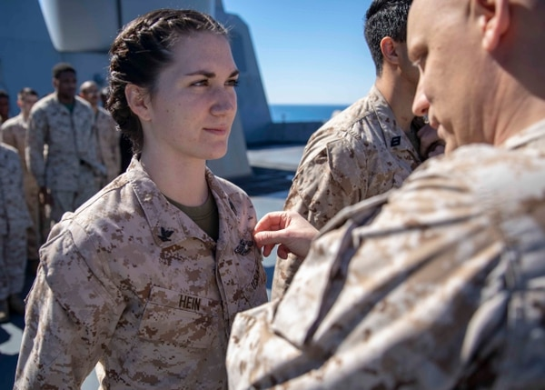 Hospital Corpsman 3rd Class Aubrei Hein, assigned to the 22nd Marine Expeditionary Unit, is pinned with the Fleet Marine Force Specialist Device on board the amphibious transport dock ship Arlington on March 16. The Arlington was sailing the Mediterranean Sea. (Staff Sgt. Andrew Ochoa/Marine Corps)