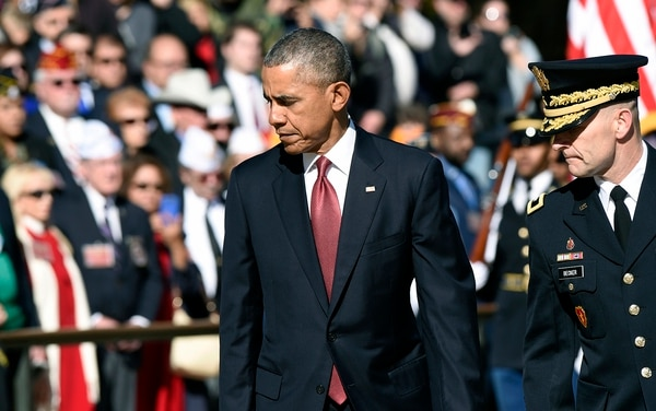 President Barack Obama, accompanied by Maj. Gen. Bradley A. Becker, Commanding General , U.S Army Military District of Washington, turns back after laying a wreath at the Tomb of the Unknowns, Wednesday, Nov. 11, 2015, at Arlington National Cemetery in Arlington, Va. during Veterans Day ceremonies. (AP Photo/Susan Walsh)