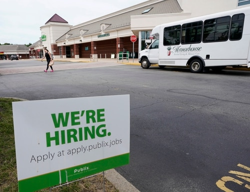 A sign advertising jobs sits outside a Publix supermarket in Richmond, Va., on June 2. (Steve Helber/AP)