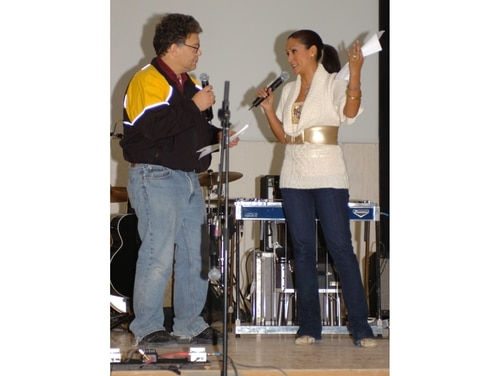 Al Franken and Leann Tweeden entertain soldiers with a skit at Forward Operating Base Marez in Mosul, Iraq, Dec. 16, 2006. Tweeden has accused Franken, now a senator from Minnesota, of groping and kissing her without her consent during the tour. (Spc. Creighton Holub/Army)