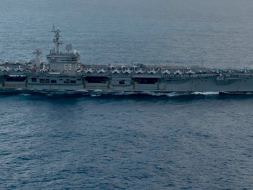 The aircraft carrier Dwight D. Eisenhower transits the Atlantic Ocean Jan. 25. After just a few months home, the aging Ike will soon deploy again. (MC3 Sawyer Haskins/Navy)
