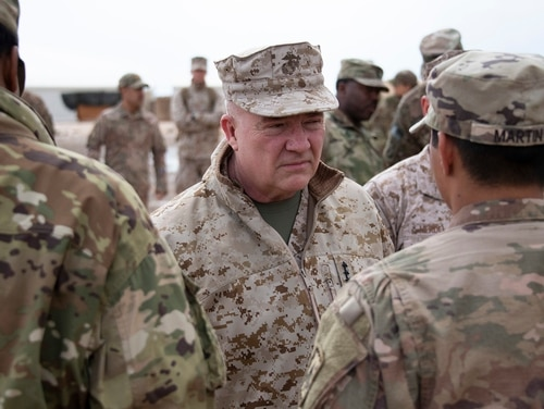 Marine Corps Gen. Kenneth McKenzie, the commander of U.S. Central Command, center, visits airmen assigned to the 332 Air Expeditionary Wing, Jan. 24, 2020, at an undisclosed location. (Staff Sgt. Alexandria Brun/Air Force)