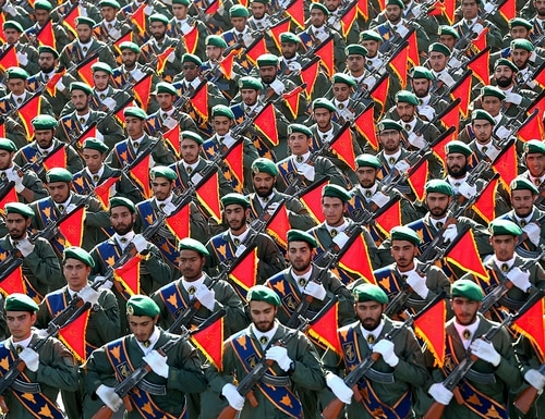 In this Sept. 21, 2016, file photo, Iran's Revolutionary Guard troops march in a military parade marking the 36th anniversary of Iraq's 1980 invasion of Iran, in front of the shrine of late revolutionary founder Ayatollah Khomeini, just outside Tehran. (Ebrahim Noroozi/AP)