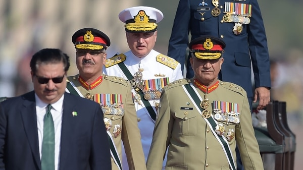 Pakistani Chief of Naval Staff Adm. Zafar Mahmood Abbasi, center, arrives will fellow officers to receive Sri Lankan President Maithripala Sirisena during the Pakistan Day military parade in Islamabad on March 23, 2018. (Aamir Qureshi/AFP via Getty Images)