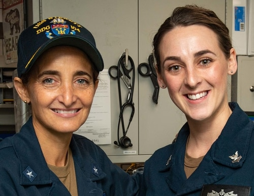 Rear Adm. Yvette Davids (left), commander of Carrier Strike Group 11, meets with Hospital Corpsman 2nd Class Sarah Brown, the strike group's junior sailor of the year, aboard the destroyer Sterett Feb. 2. Davids has been named the new chief of staff of U.S. Southern Command. (MC3 James Hong/Navy)