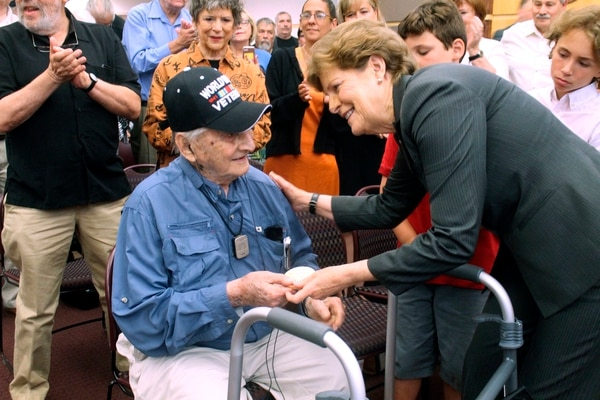 Retired Army Capt. Martin Gelb is presented with the Congressional Gold Medal by U.S. Sen. Jeanne Shaheen, D-N.H., on Monday, June 25, 2018, in Derry, New Hampshire. Gelb, 98, was honored for his World War II service with the Office of Strategic Services, the precursor to the Central Intelligence Agency. (AP Photo/Holly Ramer)