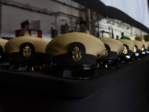 Chief petty officer combination covers prior to the pinning ceremony inside the aircraft carrier Ronald Reagan last year. (MC3 Macadam Weissman/Navy)