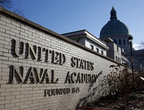 A sign stands outside of an entrance to the U.S. Naval Academy campus in Annapolis, Md., on Jan. 9, 2014. The campus is taking precautions to prevent the spread of a new strain of coronavirus. (Patrick Semansky/AP)