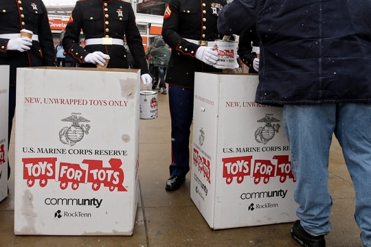 Marines collect toys and donations for the Toys for Tots campaign outside FirstEnergy Stadium before an NFL football game between the Chicago Bears and the Cleveland Browns Sunday, Dec. 15, 2013, in Cleveland. (Mark Duncan/AP)