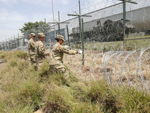 Soldiers stretch out concertina wire used to secure the existing border fence near the World Trade International Bridge in Laredo, Texas, April 11, 2019. (Sgt. Andrew S. Valles/Army)