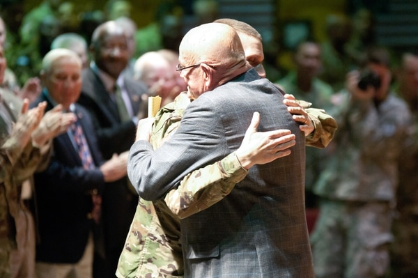 U.S. Army Ret. Gen. Gordon R. Sullivan hugs Sgt. Maj. of the Army Daniel A. Dailey after being inducted as an honorary sergeant major during the 2016 International Training and Leader Development Symposium at Fort Bliss, TX on April 12, 2016. Sullivan has dedicated more than 61 years of service to the United States Army and currently serves as the president and chief executive officer of the Association of the U.S. Army. (Army photo by Sgt. Jessica R. Littlejohn/ 24th Press Camp Headquarters)