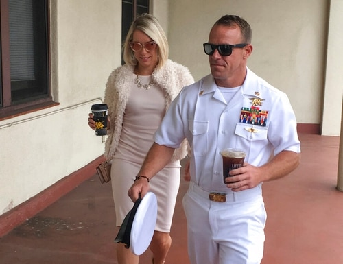 "Navy Special Warfare Operator Chief Edward ""Eddie"" Gallagher walks with his wife Andrea as they arrive at a military courtroom inside Naval Base San Diego on Monday. (Julie Watson/AP)"