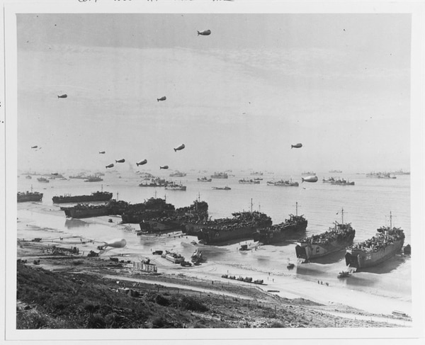 Landing Ships Tank (LST) land invasion supplies on Omaha Beach, shortly after the 6 June 1944 D-Day assault. (National Archives)