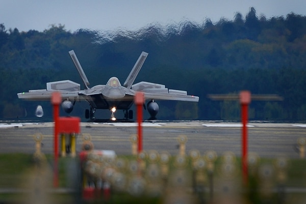 An F-22 Raptor from the 1st Fighter Wing lands at Royal Air Force Lakenheath, England, Sunday. The Air Force has deployed F-22s, airmen and equipment for a flying training deployment to conduct air training with other Europe-based U.S. aircraft and NATO allies. (Tech. Sgt. Matthew Plew/Air Force)