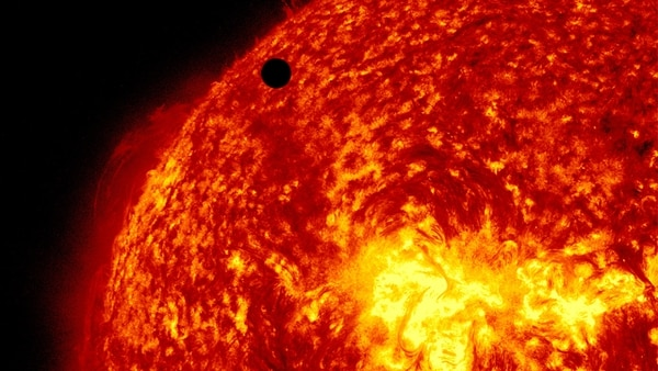 Venus crossed the left limb of the sun, seen here at 304 angstroms, between 6 and 7 p.m. EDT on June 5, 2012. (NASA)