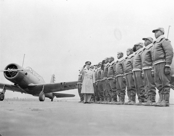 Soon to be added to the nation's fighting forces will be an all-black aviation squadron, whose members now are in training at Tuskegee Institute, Tuskegee, Ala. Some of the cadets at the Basic and Advanced Flying School for Negro Air Corps Cadets are shown here, Jan. 23, 1942, lined up for review with Maj. James A. Ellison returning the salute of Mac Ross of Dayton, Ohio, as he inspects the cadets. (U.S. Army Signal Corps via AP)