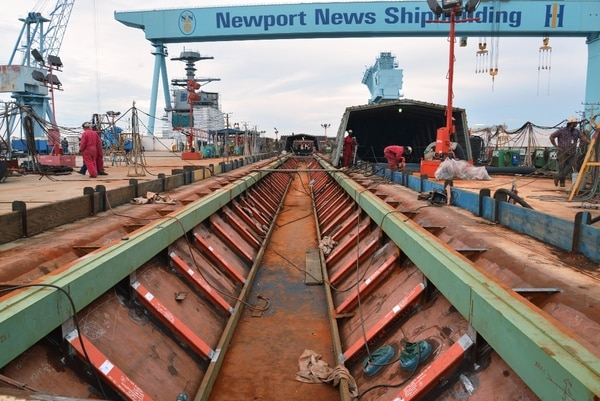 The Gerald R. Ford (CVN 78) sits in the graving dock at Newport News Shipbuilding, awaiting her Nov. 9 christening ceremony. The trough that will hold the No. 3 EMALS catapult.