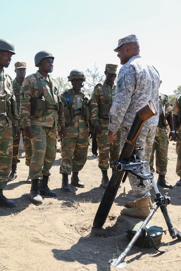 Maj. Gen. Darryl A. Williams, U.S. Army Africa commander is speaking with a Zambian Mortor team during Exercise Southern Accord 2015, held in Lusaka, Zambia, Aug. 3-14. The Southern Accord Exercise brings together the U.S. Army, Zambian Defense Force, Southern African Development Community and other partner nation participants for two weeks of command post and field training exercises. (U.S. Army Photo by Spc. Craig Philbrick)