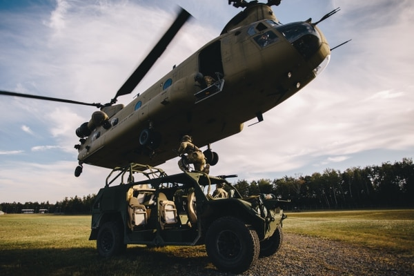 Paratroopers assigned to 1st Squadron (Airborne), 91st Cavalry Regiment, 173rd Airborne Brigade sling load a Ground Mobility Vehicle to a CH-47 Chinook in preparation for air assaulting into Hohenfels Training Area, Germany during Exercise Saber Screen 19, July 22, 2019. (Spc. Ryan Lucas, Army)