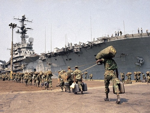 U.S. Marines prepare to board ship at Danang in 1970 for trip back to U.S. under withdrawal orders. On Tuesday, a federal court ordered VA to award presumptive disability benefit status to thousands of Vietnam veterans who served on ships in the waters around that country. (AP Photo)